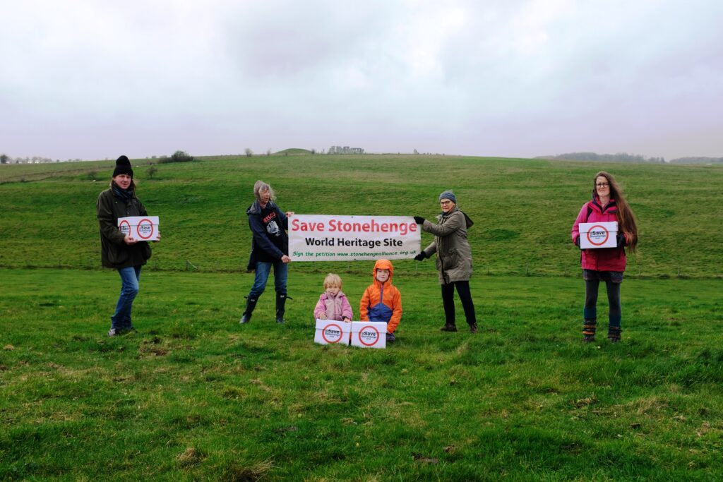 Three generations of campaigners at Stonehenge ready to send boxes of petition signatures